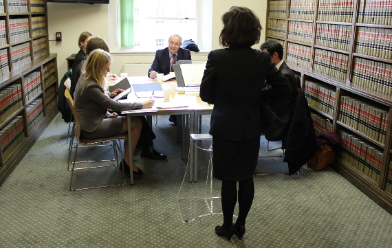 Master Kearns judging a moot heat in the Rosamund Smith Mooting Competition